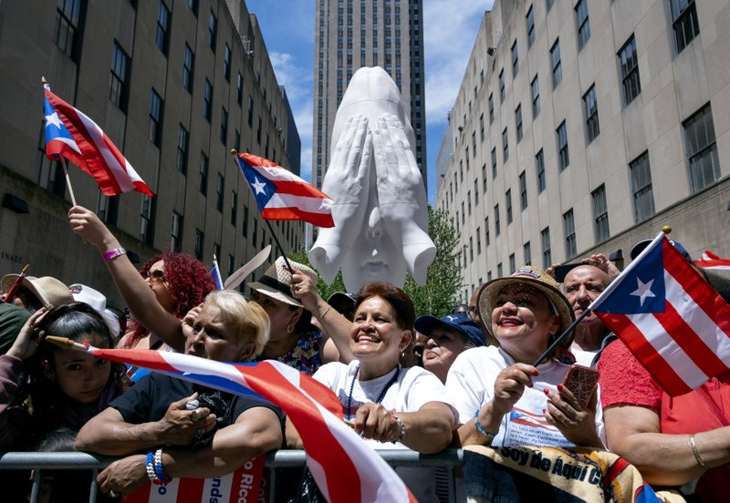 Spectators take part in the National Puerto Rican Day Parade Sunday, June 9, 2019, in New York. (AP Photo/Craig Ruttle)