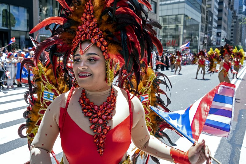 A member of a parade unit entertains spectators during the National Puerto Rican Day Parade Sunday, June 9, 2019, in New York. (AP Photo/Craig Ruttle)