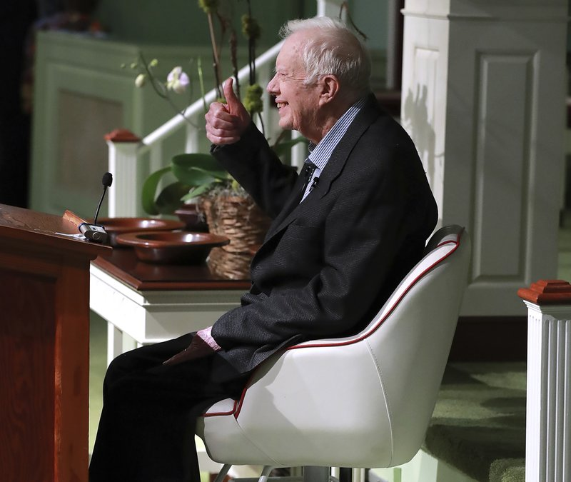 Former President Jimmy Carter smiles and gives the thumbs up as he returns to Maranatha Baptist Church to teach Sunday School on Sunday, June 9, 2019, less than a month after falling and breaking his hip, in Plains Ga. A member of the congregation made a special chair for Carter from a boat seat that would raise and lower the president. (Curtis Compton/Atlanta Journal-Constitution via AP)