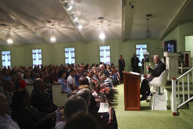 Former President Jimmy Carter returns to Maranatha Baptist Church to teach Sunday School on Sunday, June 9, 2019, less than a month after falling and breaking his hip, in Plains Ga. A member of the congregation made a special chair for Carter from a boat seat that would raise and lower the president. (Curtis Compton/Atlanta Journal-Constitution via AP)