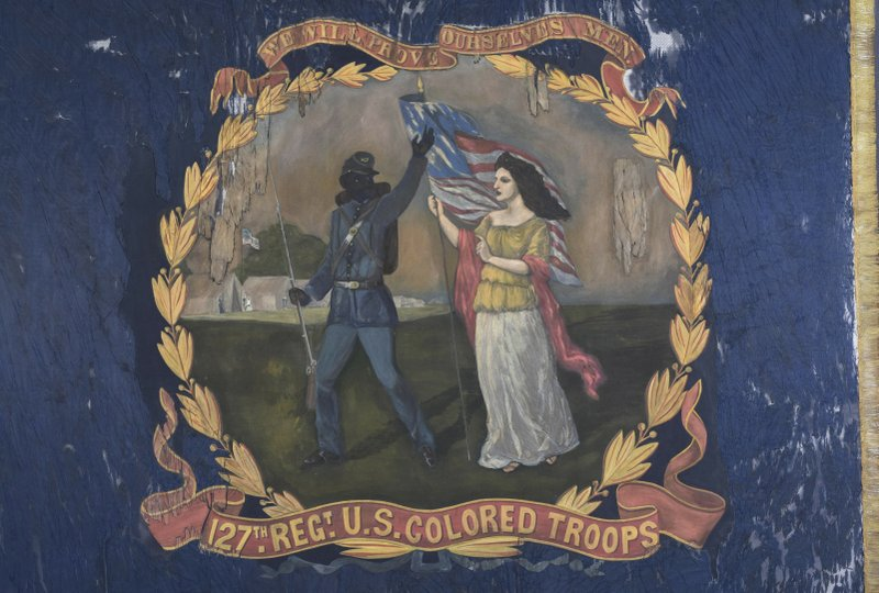 This undated photo provided by Morphy Auctions shows a 127th Regiment United States Colored Troops battle flag in Denver, Pa. The flag was carried into battle by one of the 11 black Union regiments during the Civil War, and is going up for auction in Pennsylvania. The flag was painted by David Bustill Bowser, an African American artist who was a member of one of the regiments and the son of a fugitive slave. (Morphy Auctions via AP)
