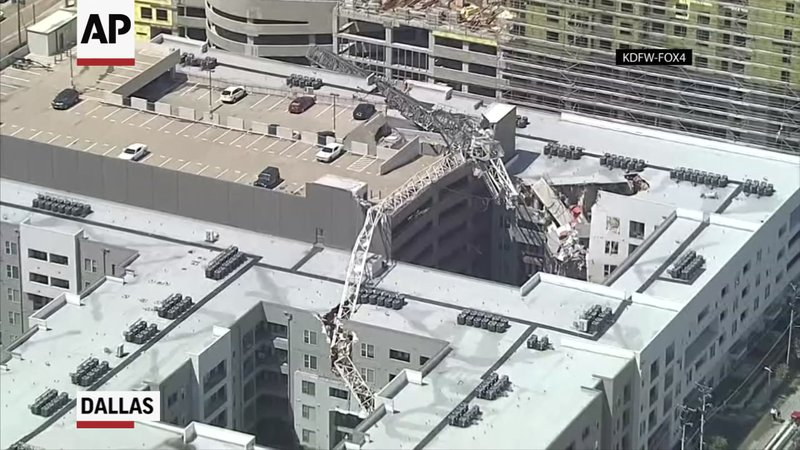 One person was killed and several others were injured after a construction crane toppled on an apartment building in Dallas on Sunday. (June 9)