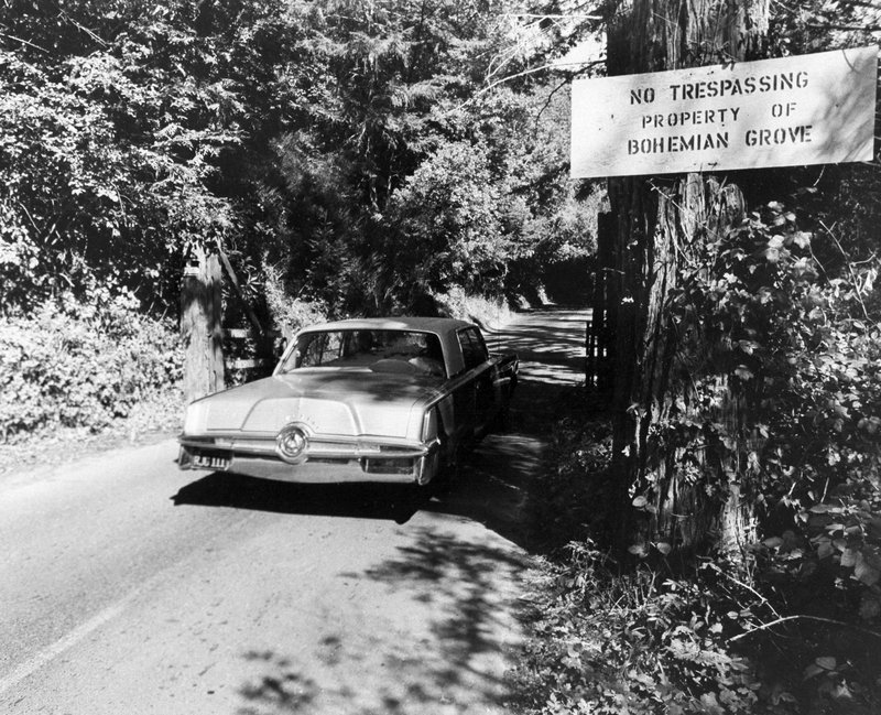 FILE - In this July 29, 1971 file photo is the roadway into the exclusive Bohemian Grove, a quiet encampment 80 miles north of San Francisco in Monte Rio, Calif. A retreat for members of the elite Bohemian Club is facing renewed scrutiny for excluding women. This comes after the Sonoma County Board of Supervisors raised questions about whether sheriff's deputies should provide security for an event that discriminates by gender.  (AP Photo/Sal Veder, File)