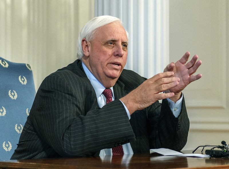 FILE - In this Feb. 19, 2019, file photo, West Virginia Gov. Jim Justice speaks during a press conference at the state Capitol in Charleston, W.Va. West Virginia Gov. Jim Justice criticized former New York City Mayor Michael Bloomberg's $500 million effort to close the nation's coal plants at a news conference Monday, June 10, 2019, saying it will destroy the economy of his coal-producing state. (Craig Hudson/Charleston Gazette-Mail via AP, File)