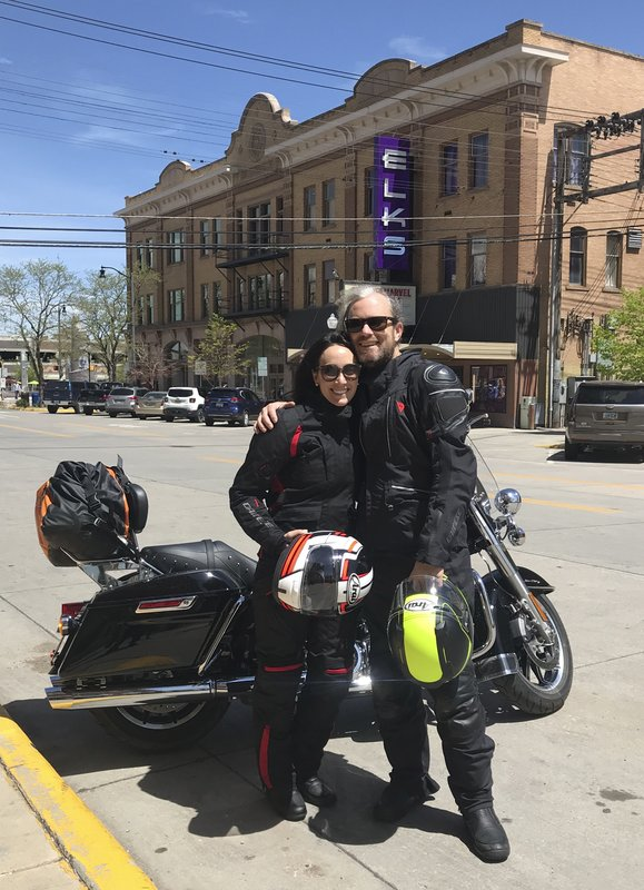 In this photo taken May 26, 2019, Jaclyn Trop is with automotive journalist Davey G. Johnson in Rapid City, South Dakota. Authorities using boats and drones are searching a river for Johnson, a veteran automotive journalist who went missing in Northern California while test-driving a motorcycle for a story. Calaveras County Lt. Anthony Eberhardt said Monday, June 10, 2019, crews are searching the Mokelumne River and a reservoir for David Gordon Johnson, who was reported missing June 5. Eberhardt said no foul play is suspected. (Jaclyn Trop via AP)