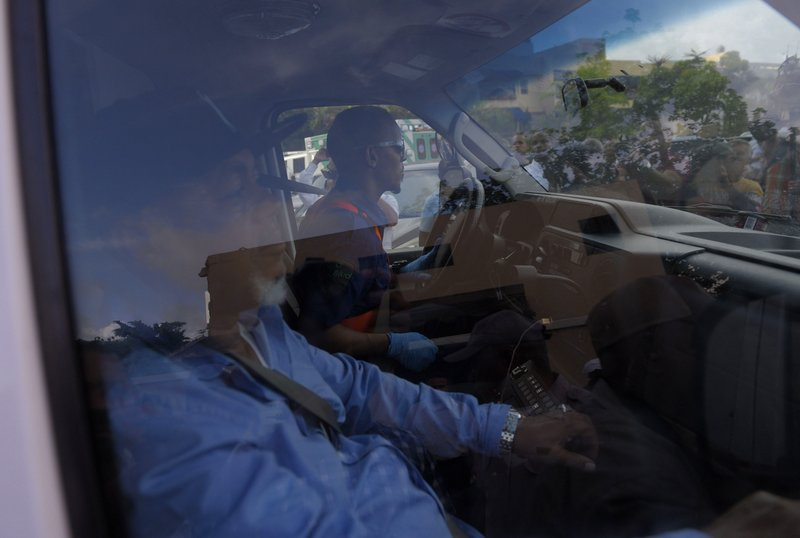 Leo Ortiz, left, the father of former Boston Red Sox slugger David Ortiz, sits in the ambulance that carries his son to the airport from at the hospital where he was hospitalized after being shot the previous day in Santo Domingo, Dominican Republic, Monday, June 10, 2019. Doctors removed Ortiz's gallbladder and part of his intestine after the beloved former Boston Red Sox slugger known as Big Papi was ambushed by a gunman at a bar in his native Dominican Republic, a spokesman said Monday. (AP Photo/Roberto Guzman)
