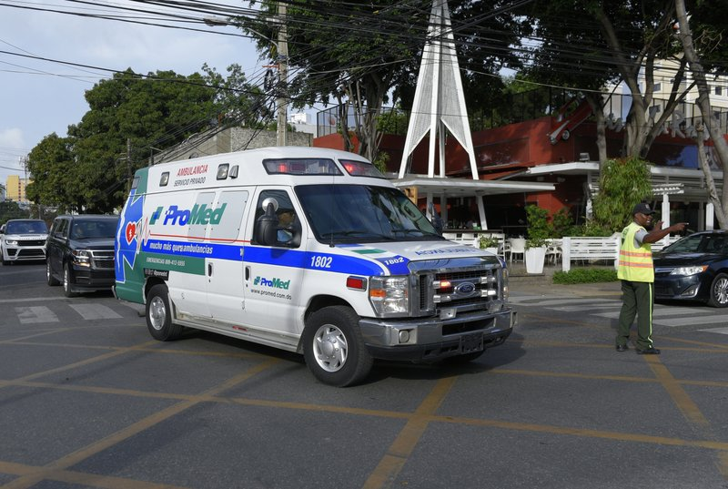 Leo Ortiz, father of former Boston Red Sox slugger David Ortiz, rides in the passenger seat of the ambulance carrying his son from the hospital where David was hospitalized after being shot the previous day, to the airport to be flown to Boston, in Santo Domingo, Dominican Republic, Monday, June 10, 2019. Doctors removed Ortiz's gallbladder and part of his intestine after the beloved former Boston Red Sox slugger known as Big Papi was ambushed by a gunman at a bar in his native Dominican Republic, a spokesman said Monday. (AP Photo/Roberto Guzman)