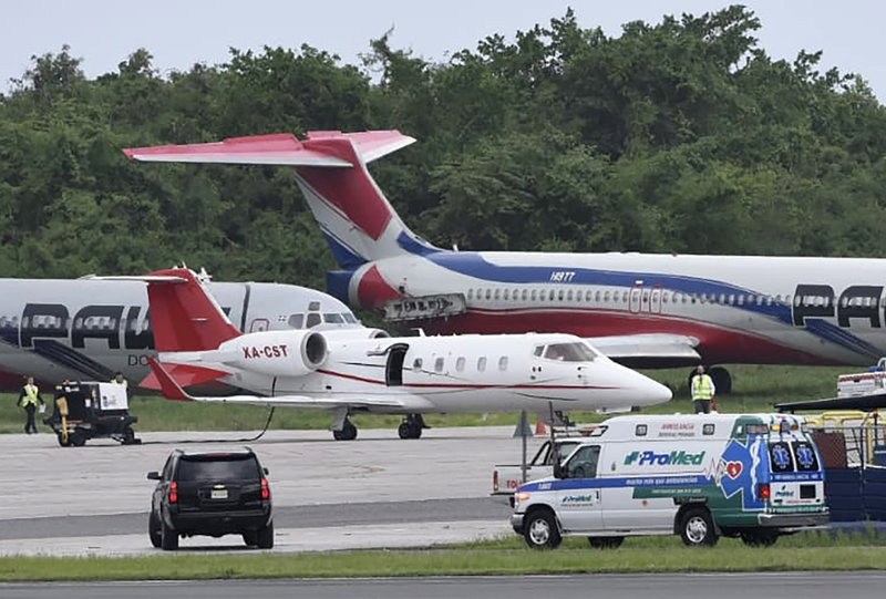The ambulance carrying former Boston Red Sox slugger David Ortiz arrives to transfer him to the small ambulance plane parked at Las Americas Airport which will fly him to Boston, in Santo Domingo, Dominican Republic, Monday, June 10, 2019. Doctors removed Ortiz s gallbladder and part of his intestine after the beloved former Boston Red Sox slugger known as Big Papi was ambushed the previous day by a gunman at a bar in his native Dominican Republic, a spokesman said Monday. (AP Photo/Juan Miguel Peña)
