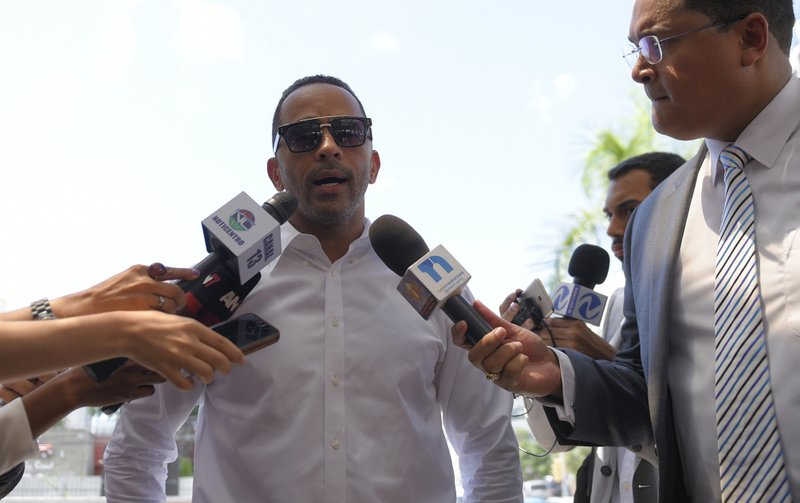 Julio Lugo, former teammate of former Boston Red Sox slugger David Ortiz, speaks to the press outside the hospital where Ortiz is being treated after he was shot the previous day in Santo Domingo, Dominican Republic, Monday, June 10, 2019. Doctors removed Ortiz's gallbladder and part of his intestine after the beloved former Boston Red Sox slugger known as Big Papi was ambushed by a gunman at a bar in his native Dominican Republic, a spokesman said Monday. (AP Photo/Roberto Guzmán)