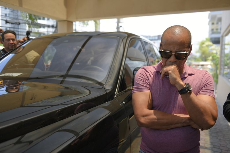 Eliezer Salvador, who said he took former Boston Red Sox slugger David Ortiz to the hospital after he was shot the day before, reacts outside the hospital where Ortiz is being treated in Santo Domingo, Dominican Republic, Monday, June 10, 2019. Doctors removed Ortiz's gallbladder and part of his intestine after the beloved former Boston Red Sox slugger known as Big Papi was ambushed by a gunman at a bar in his native Dominican Republic, a spokesman said Monday. (AP Photo/Roberto Guzmán)