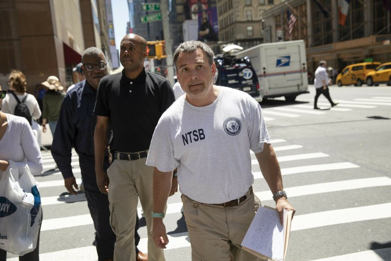Doug Brazy, an investigator with the National Transportation Safety Board, arrives for a news conference, Tuesday, June 11, 2019 in New York. He gave an update on Monday's helicopter crash on the roof of a rain-shrouded Manhattan skyscraper, which killed the pilot, Tim McCormack, of Clinton Corners, N.Y. (AP Photo/Mark Lennihan)