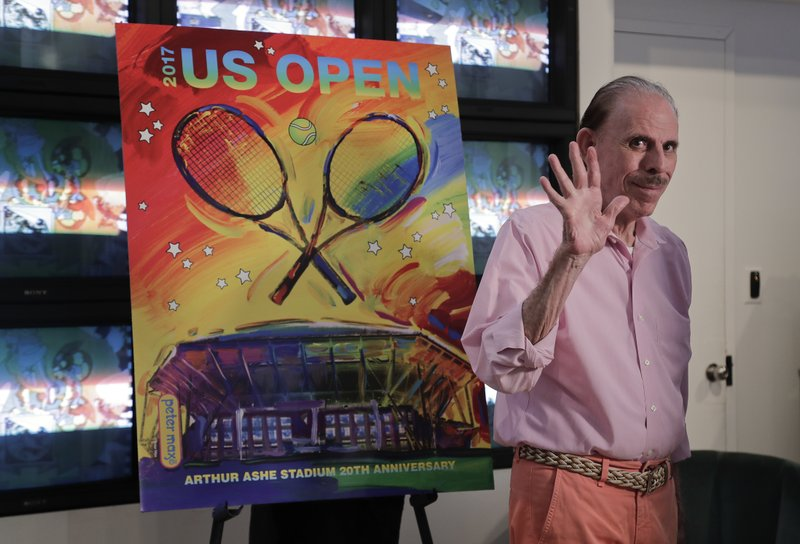 FILE - In this June 14, 2017, file photo, artist Peter Max acknowledges applause during the unveiling of the theme art he created for the 2017 U.S. Open tennis tournament in New York. Authorities say Mary Max, 53, the wife of the artist Peter Max, was found dead Sunday, June 9, 2019, in New York, of a suspected suicide amid a family fight over her husband's work. Her death comes two weeks after The New York Times published a story detailing legal battles over the work of Peter Max, a prolific creator of colorful, psychedelic art who is now living with dementia at age 81.  (AP Photo/Julie Jacobson, File)