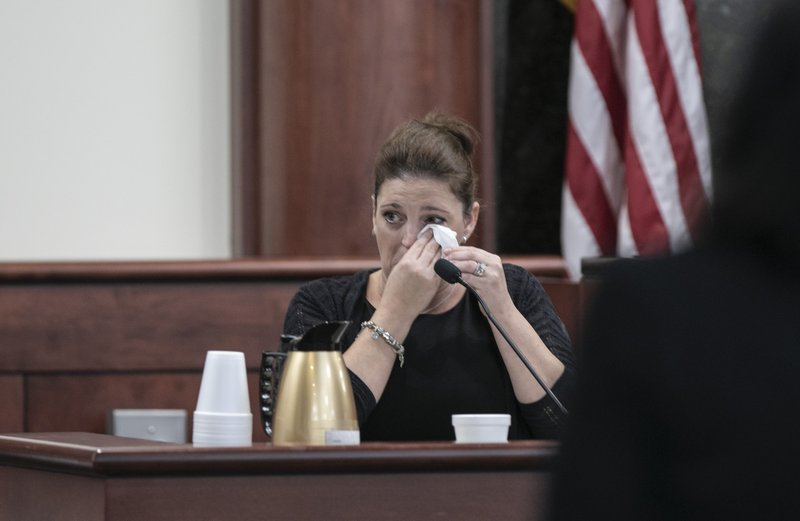 Amber Kyzer, mother of five children who were killed by their father, is questioned by 11th Circuit deputy Solicitor Suzanne Mayes during the sentencing phase of the trial of her ex-husband, Tim Jones, in Lexington, S.C., on Tuesday, June 11, 2019.  A jury convicted Jones of five counts of murder last week for the Aug. 2014 killings.  (Tracy Glantz/The State via AP, Pool)