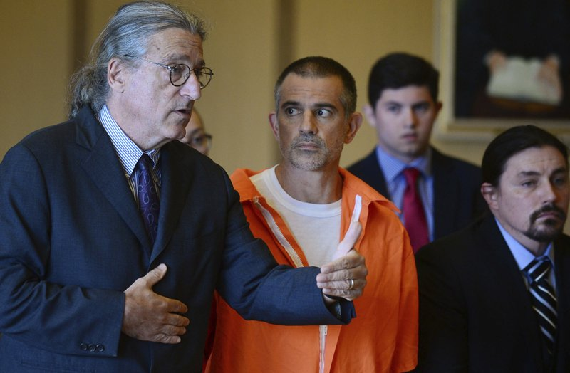 Fotis Dulos, center, listens, as his attorney Norm Pattis, left, addresses the court during a hearing at Stamford Superior Court, Tuesday, June 11, 2019 in Stamford, Conn. Fotis Dulos, and his girlfriend, Michelle Troconis, have been charged with evidence tampering and hindering prosecution in the disappearance of his wife Jennifer Dulos. The mother of five has has been missing since May 24. (Erik Trautmann/Hearst Connecticut Media via AP, Pool)