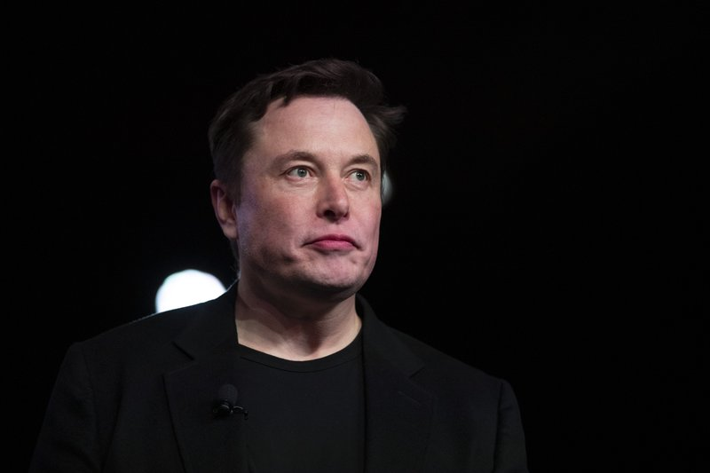 FILE - In this March 14, 2019, file photo Tesla CEO Elon Musk pauses while speaking before unveiling the Model Y at the company's design studio in Hawthorne, Calif. Musk will face the electric car maker's shareholders during the company's annual meeting on Tuesday, June 11. (AP Photo/Jae C. Hong, File)