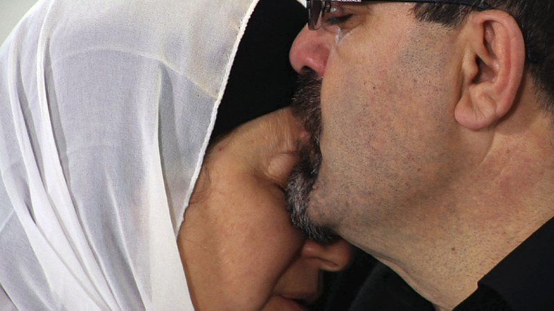 FILE - In a February 2015 file photo, Namee Barakat hugs a female relative during a news conference in Raleigh, N.C., about the death of his son, Deah, his daughter-in-law and her sister. Barakat said the death penalty