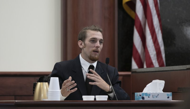 Tyler Jones testifies during the sentencing phase of the trial of his half brother, Tim Jones in Lexington  S.C., Wednesday, June 12, 2019. Timothy Jones, Jr. was found guilty of killing his 5 young children in 2014. (Tracy Glantz/The State via AP, Pool)