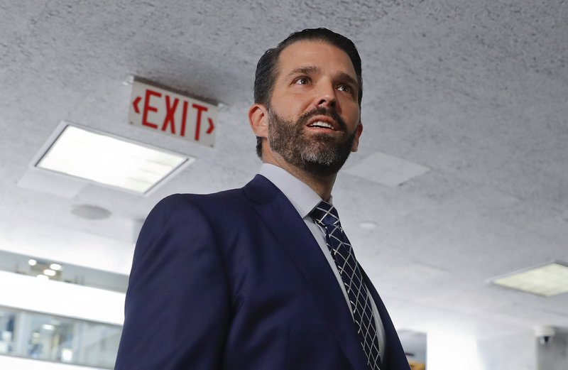 Donald Trump Jr., the son of President Donald Trump, is seen leaving after having met privately with members of the Senate Intelligence Committee on Capitol Hill on Washington, Wednesday, June 12, 2019 (AP Photo/Pablo Martinez Monsivais)