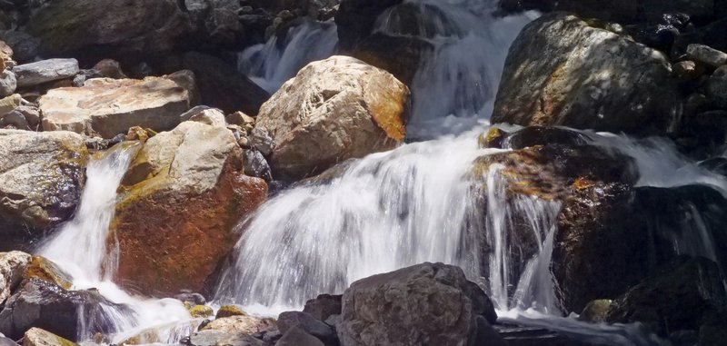 This Monday, June 10, 2019, photo shows mountain runoff, in the Big Cottonwood canyon, near Salt Lake City. The summer's melting snowpack is creating raging rivers that are running high, fast and icy cold. The state's snowpack this winter was about 150 percent higher than the historical average and double the previous year, which was the driest on record dating back to 1874, said Brian McInerney, hydrologist for the National Weather Service in Salt Lake City. (AP Photo/Rick Bowmer)