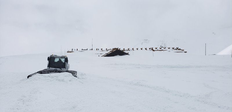 This May 29, 2019, photo provided by the National Park Service shows a plow clearing roof-high snow from the parking lot at the Alpine Visitor Center in Rocky Mountain National Park, Colo. The building is 11,796 feet (3,595 meters) above sea level. Heavy winter snow and a cold, wet May in the Rocky Mountains are sending a welcome surge of spring runoff into the rivers of the Southwestern U.S., fending off a water shortage but threatening to push some streams over their banks. (National Park Service via AP)