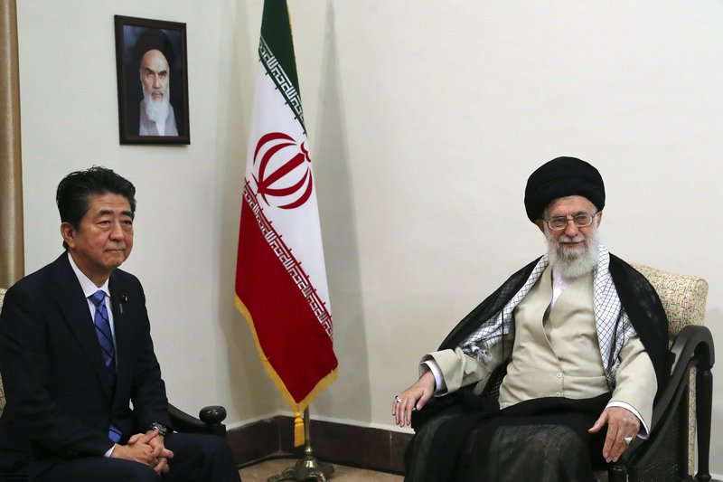 In this picture released by an official website of the office of the Iranian supreme leader, Supreme Leader Ayatollah Ali Khamenei, right, meets with Japanese Prime Minister Shinzo Abe, in Tehran, Iran, Thursday, June 13, 2019. A portrait of the late Iranian revolutionary founder Ayatollah Khomeini hangs on the wall. (Office of the Iranian Supreme Leader via AP)