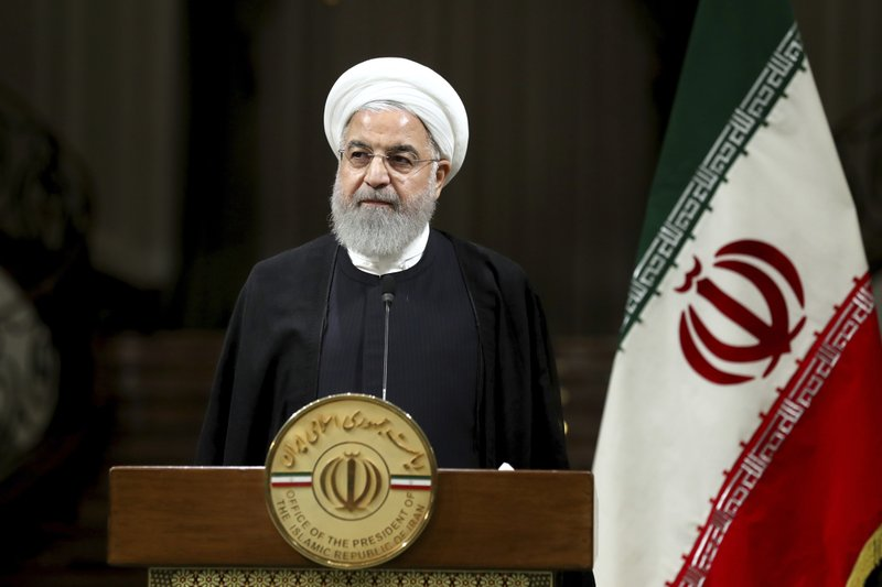 Iranian President Hassan Rouhani listens during a joint press conference with Japanese Prime Minister Shinzo Abe, after their meeting at the Saadabad Palace in Tehran, Iran, Wednesday, June 12, 2019. The Japanese leader is in Tehran on an mission to calm tensions between the U.S. and Iran. (AP Photo/Ebrahim Noroozi)