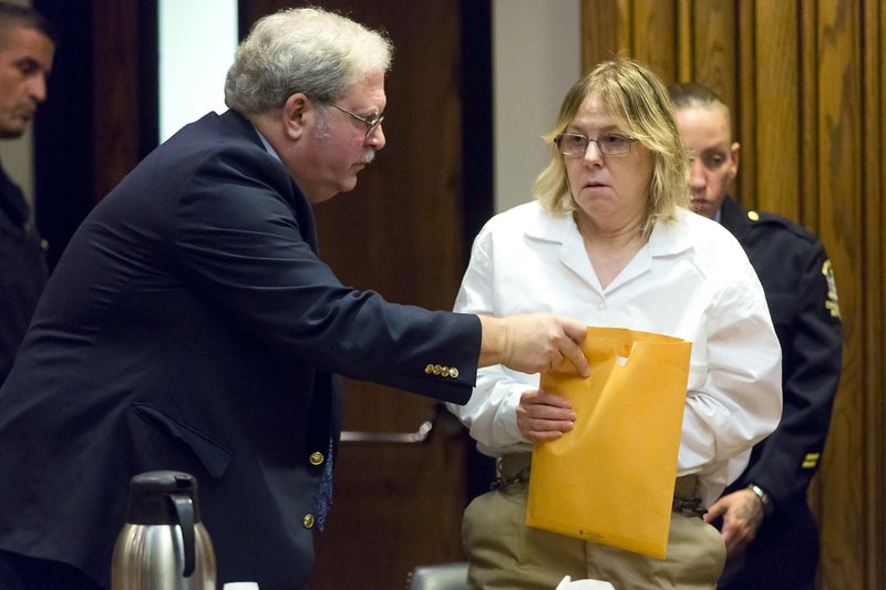 FILE - This Nov. 6, 2015 file photo shows Joyce Mitchell, a former prison employee who provided the tools that two murderers used to cut their way out of a maximum-security facility in northern New York, accompanied by her attorney Steven Johnston, at the Clinton County Government Center, in Plattsburgh, N.Y. A parole board decision released Thursday, June 13, 2019 says Joyce Mitchell will remain behind bars for at least two more years. (Gabe Dickens/Press-Republican via AP)