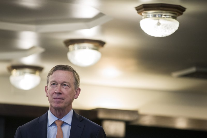 Former Colorado Governor John Hickenlooper waits as he is introduced before speaking during a media availability at the National Press Club, Thursday, June 13, 2019, in Washington. (AP Photo/Alex Brandon)