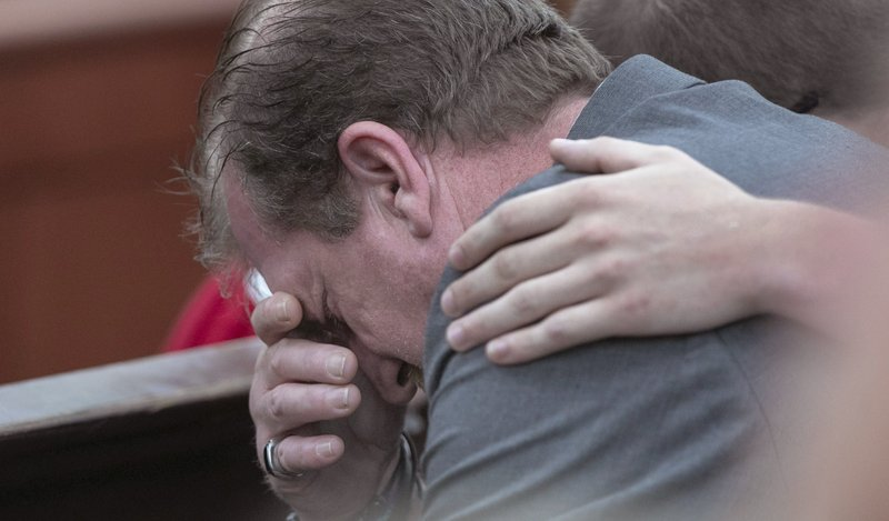 Timothy Jones, Sr. weeps as his son is sentenced to death for the killing of his 5 young children in 2014, Thursday, June 13, 2019 in Lexington, S.C.  (Tracy Glantz/The State via AP, Pool)