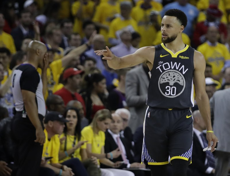 Golden State Warriors' Stephen Curry, right, gestures in the second quarter of Game 6 of basketball's NBA Finals against the Toronto Raptors Thursday, June 13, 2019, in Oakland, Calif. (AP Photo/Ben Margot)