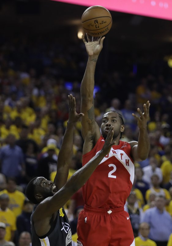 Toronto Raptors' Kawhi Leonard, right, shoots over Golden State Warriors' Draymond Green in the second quarter of Game 6 of basketball's NBA Finals Thursday, June 13, 2019, in Oakland, Calif. (AP Photo/Ben Margot)
