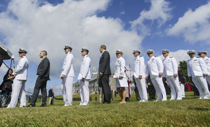 Members of the graduating class of 2019 lineup for the ceremony during the U.S. Naval War College's commencement ceremony, Friday, June 14, 2019, in Newport, R.I. (AP Photo/Stew Milne)