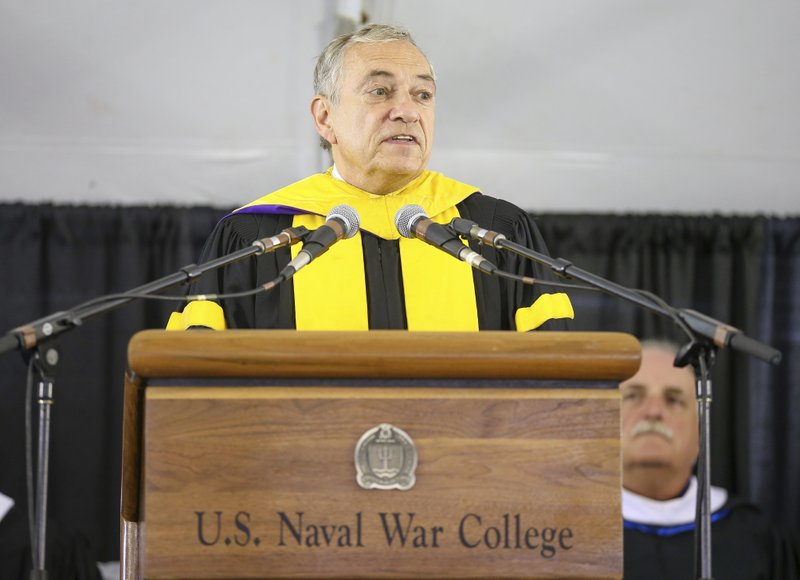 Acting President of the U.S. Naval War College Dr. Lewis Duncan addresses the graduates during the U.S. Naval War College's commencement ceremony, Friday, June 14, 2019, in Newport, R.I. (AP Photo/Stew Milne)