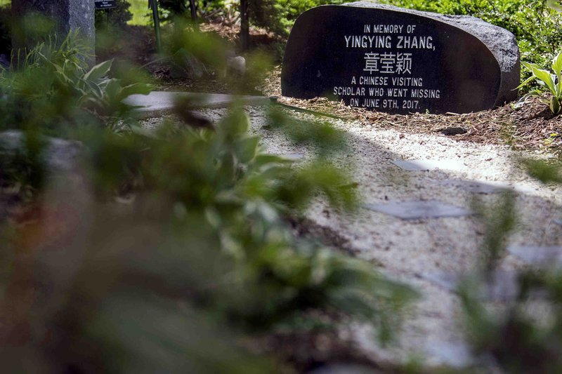 The memorial garden for Yingying Zhang is seen outside of Campbell Hall Thursday, June 13, 2019, on the University of Illinois campus in Urbana, Ill. (Stephen Haas/The News-Gazette via AP)