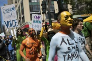 Protesters strip, get painted in Times Square