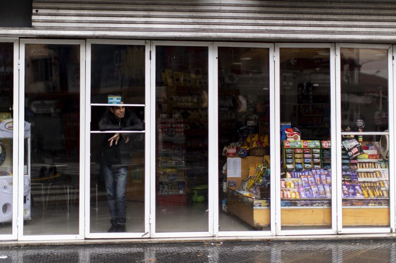 A man stands inside a store without power during a blackout, in Buenos Aires, Argentina, Sunday, June 16, 2019. Argentina and Uruguay were working frantically to return power on Sunday, after a massive power failure left large swaths of the South American countries in the dark. (AP Photo/Tomas F. Cuesta)