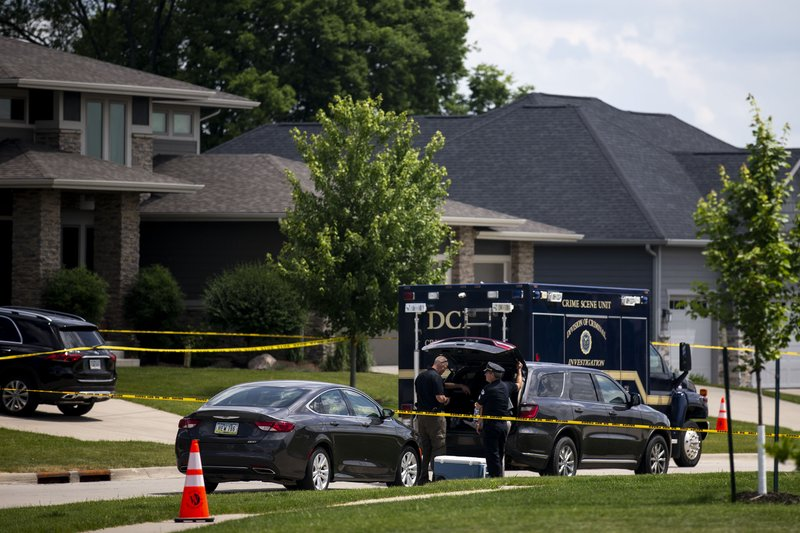 West Des Moines Police and the Iowa Division of Criminal Investigation investigate multiple deaths in a home on the 900 block of 65th Street on Saturday, June 15, 2019, in West Des Moines, Iowa. (Kelsey Kremer/The Des Moines Register via AP)