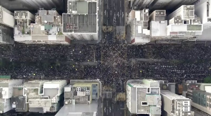 In this image from video and taken with a drone, protesters fill the Hennesy Road in Hong Kong, Sunday, June 16, 2019.  Hong Kong citizens marched for hours Sunday in a massive protest that drew a late-in-the-day apology from the city's top leader for her handling of legislation that has stoked fears of expanding control from Beijing in this former British colony.(Cable TV Hong Kong via AP)