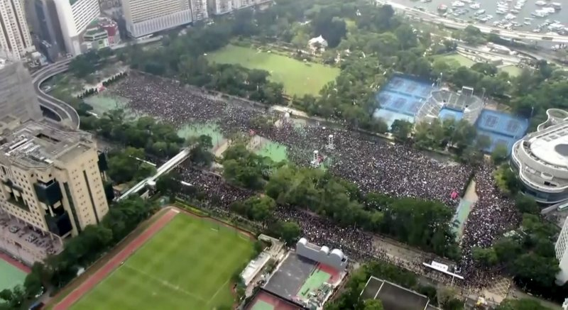 In this image from video and taken with a drone, a crowd of protesters gather at Victoria Park in Hong Kong, Sunday, June 16, 2019. Hong Kong citizens marched for hours Sunday in a massive protest that drew a late-in-the-day apology from the city's top leader for her handling of legislation that has stoked fears of expanding control from Beijing in this former British colony.(Cable TV Hong Kong via AP)