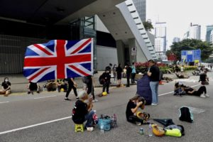 Hong Kong police begin to clear streets of protesters