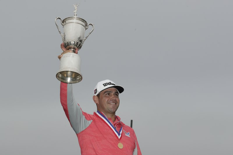 Gary Woodland celebrates with the trophy after winning the U.S. Open Championship golf tournament Sunday, June 16, 2019, in Pebble Beach, Calif. (AP Photo/Matt York)