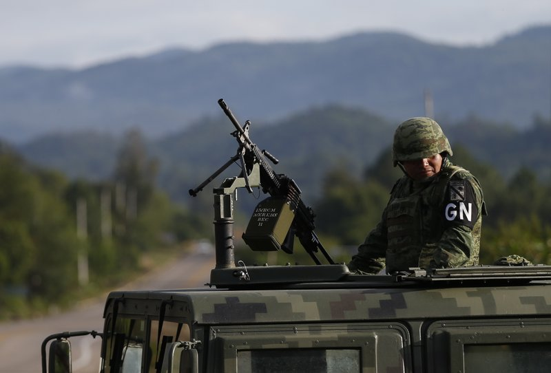 A soldier forming part of the National Guard mans an immigration checkpoint heading north out of Comitan, Chiapas state, Mexico, Sunday, June 16, 2019. Mexican President Andrés Manuel López Obrador said Saturday his country must help Central Americans fleeing poverty and violence, even as it increases security and revisions to deter migrants from passing through Mexico on route to the U.S. (AP Photo/Rebecca Blackwell)