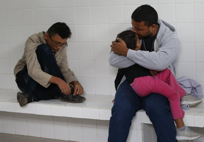 Honduran migrant Noe, 31, kisses his 4-year-old daughter Marlene as they wait inside an immigration holding cell after being removed from a bus heading north out of Comitan, Chiapas state, Mexico, Sunday, June 16, 2019. Mexican President Andrés Manuel López Obrador said Saturday his country must help Central Americans fleeing poverty and violence, even as it increases security and revisions to deter migrants from passing through Mexico on route to the U.S. (AP Photo/Rebecca Blackwell)