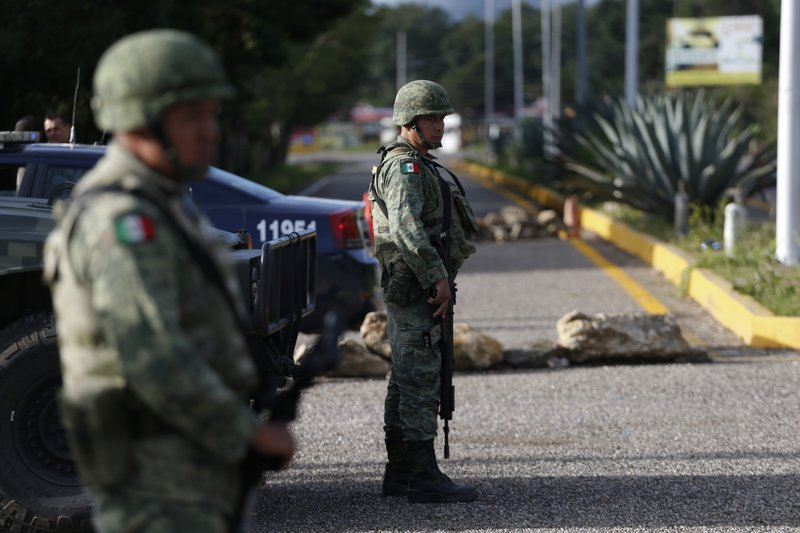 Soldiers forming part of the National Guard man an immigration checkpoint heading north out of Comitan, Chiapas state, Mexico, Sunday, June 16, 2019. Mexican President Andrés Manuel López Obrador said Saturday his country must help Central Americans fleeing poverty and violence, even as it increases security and revisions to deter migrants from passing through Mexico on route to the U.S. AP Photo/Rebecca Blackwell)