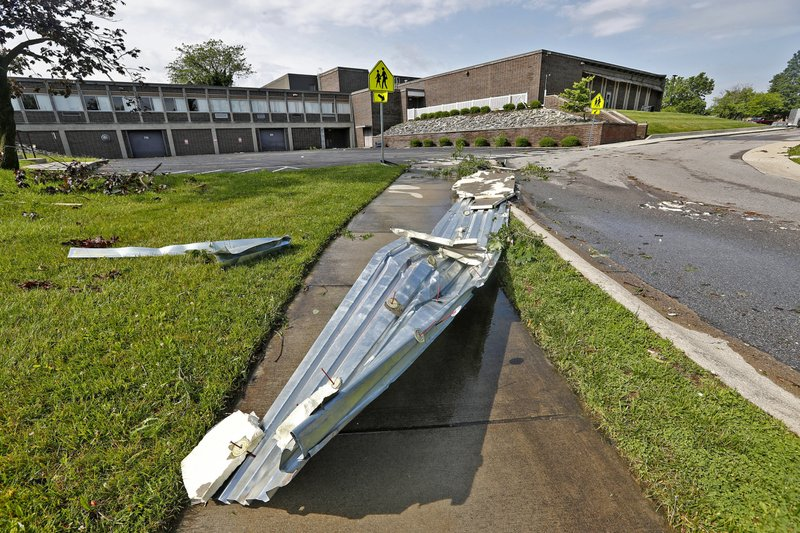 This Sunday, June 16, 2019, photo shows debris behind Beech Grove High School in Beech Grove, Ind., after a tornado moved through the area. Weather officials say severe storms in central Indiana caused floods and produced several tornadoes. (Kelly Wilkinson/The Indianapolis Star via AP)