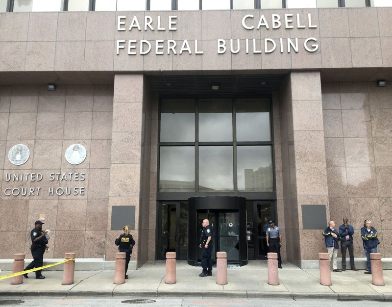 Law enforcement officers secure the scene after a man fired shots outside the Earle Cabell Federal Building in downtown Dalla,  Monday, June 17, 2019. (Tom Fox/The Dallas Morning News) MANDATORY CREDIT, NO SALES, MAGS OUT, TV OUT, INTERNET USE BY AP MEMBERS ONLY