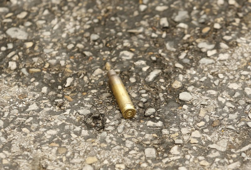 A shell casing lays on the ground after shots were fired Monday, June 17, 2019, at the Earle Cabell Federal Building in downtown Dallas. Law enforcement returned fire and the shooter was hit by gunfire. (Tom Fox/The Dallas Morning News) MANDATORY CREDIT, NO SALES, MAGS OUT, TV OUT, INTERNET USE BY AP MEMBERS ONLY