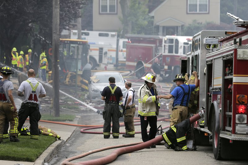 Firefighters and other emergency personnel work at the site of house explosion in Ridgefield, N.J., Monday, June 17, 2019. A home in northern New Jersey has been leveled by an explosion, but the lone person inside the residence apparently escaped serious injury. (AP Photo/Seth Wenig)