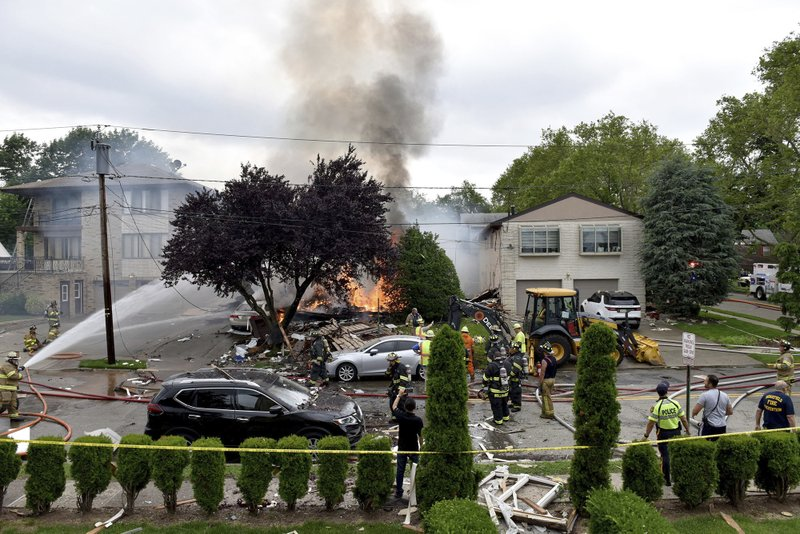 An explosion on Abbott Ave. in Ridgefield, N.J., brought mutual aid from surrounding towns to put out the fire on Monday, June 17, 2019. The lone person inside the residence apparently escaped serious injury.  (Tariq Zehawi/The Record via AP)