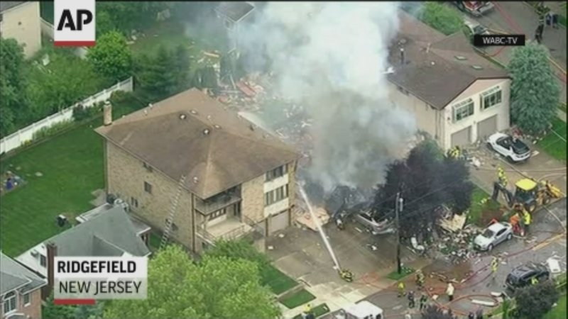 A home in northern New Jersey was leveled by an explosion Monday, but the lone person inside the residence escaped serious injury when they were pulled from the burning rubble by an off-duty police officer who lives nearby. (June 17)